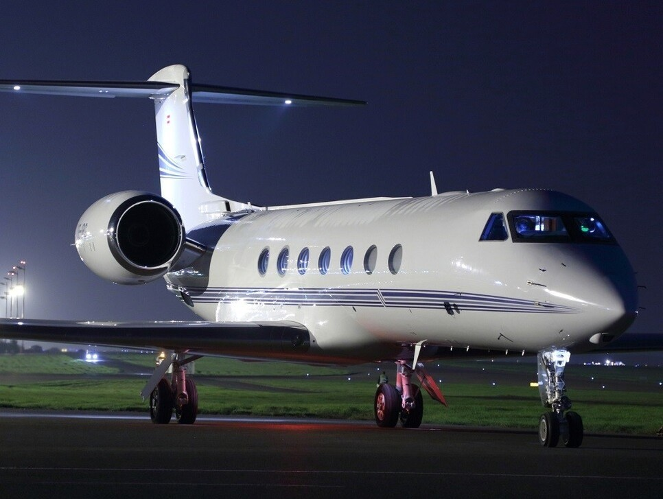 Night time on the airport ramp - Gulfstream G550 private jet