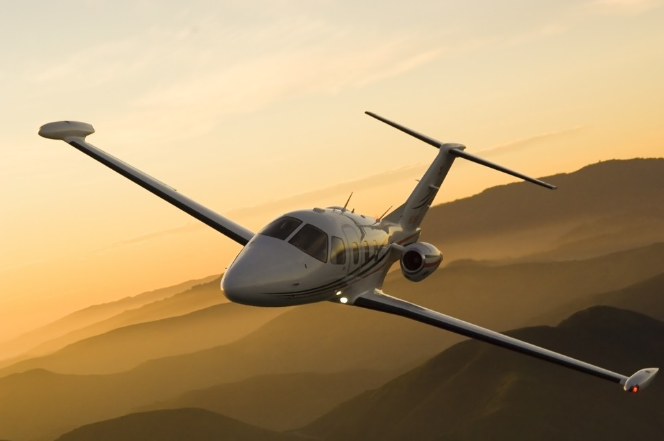 Eclipse 500 in air over mountains