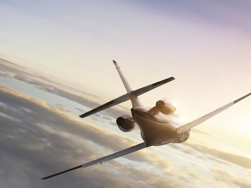 Private jet flies towards horizon