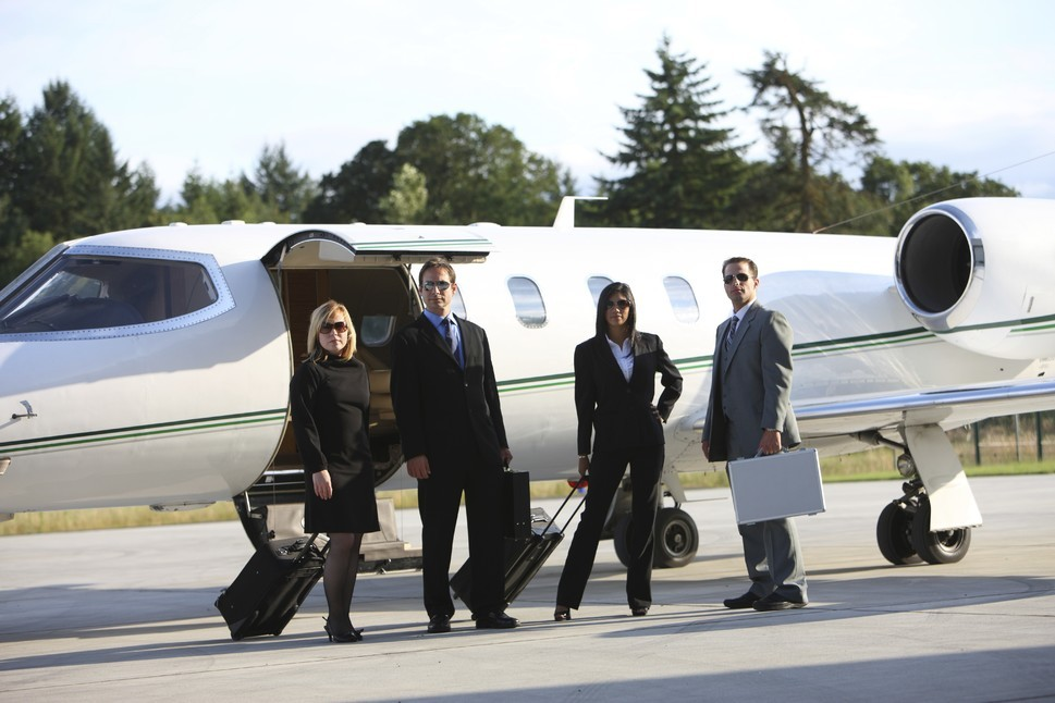 Business people with Learjet
