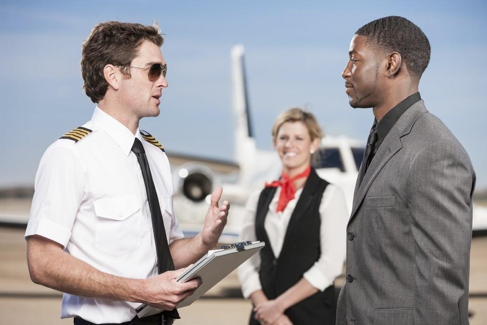 Pilot Going Over Flight Plan with Corporate Passenger