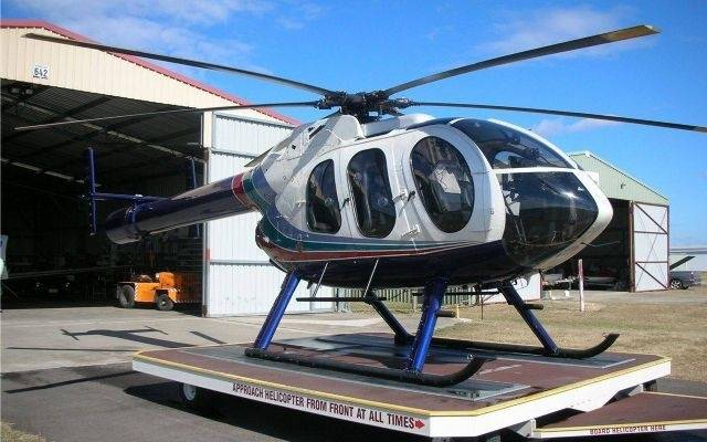 1997 mcdonnell douglas 600n static on trailer next to hangar with open doors blue sky