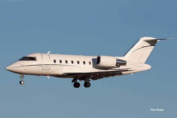 2013 canadair cl 605 in flight landing gear down coming into land blue sky