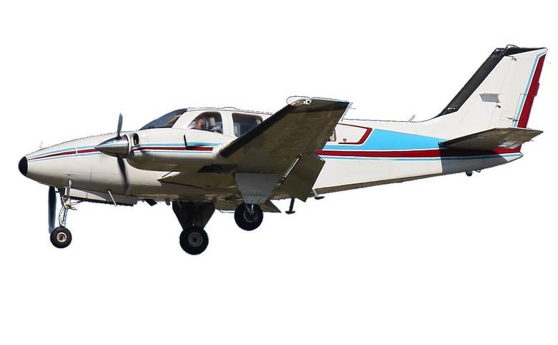 1978 beechcraft 58p baron aircraft has been cropped onto a white baackground paintwork in white with maroon and blue stripe