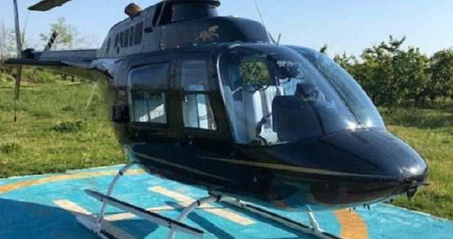 1974 bell helicopter helipad field blue sky green grass