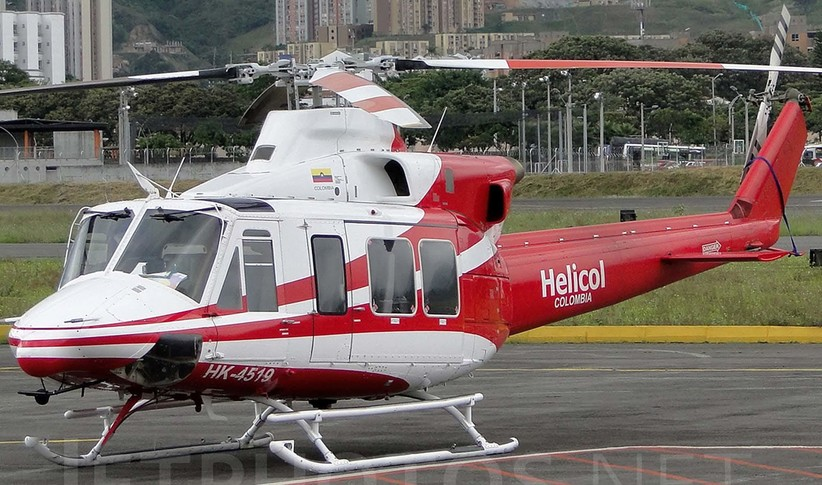 red and white bell 412ep on tarmac during the day