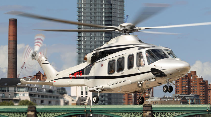 2013 agusta aw139 helicopter parked on airfield white fuselage with black accents