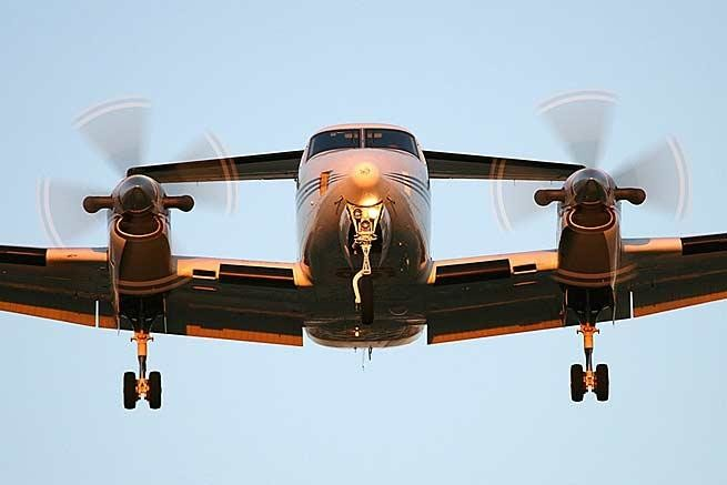 2002 beechcraft king air b200 in flight  nose on and landing gear down
