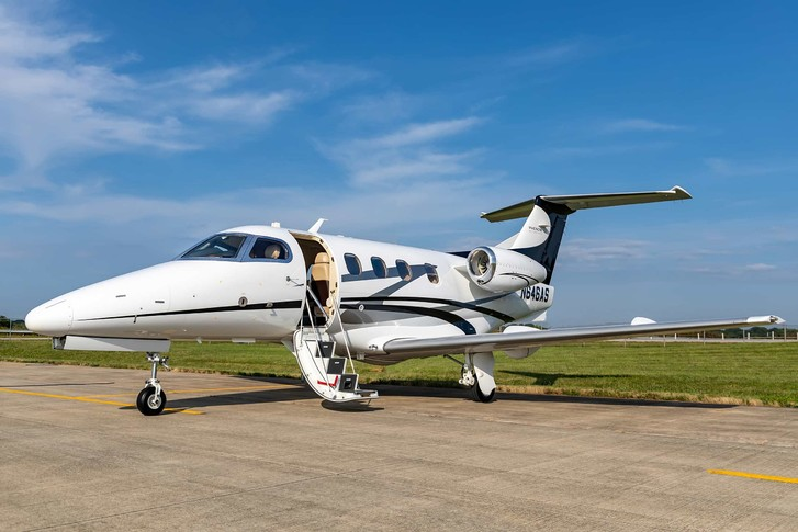 2010 embraer phenom 100 white fusleage with gray, black and red accents