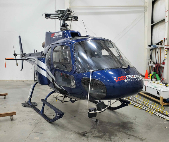 2009 eurocopter airbus as350b2 exterior. main colour is blue with silver stripes and in hangar