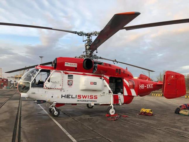 red and white heli swiss international kamove ka32 a12 heavy lift helicopter