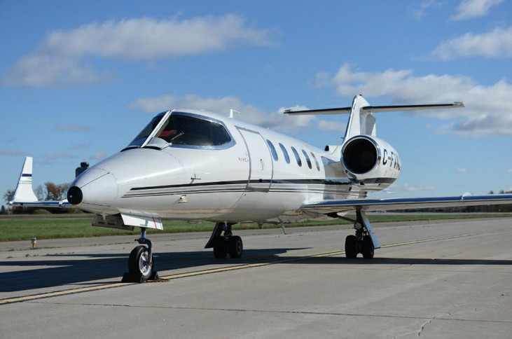 1999 bombardier learjet 31a with overall white with black, silver and charcoal accent striping