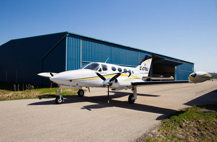 1974 cessna 414 parked outside hangar