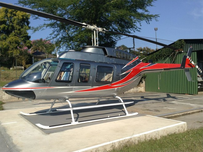 1992 bell 206l3 with champagne silver with burnt orange stripe designs