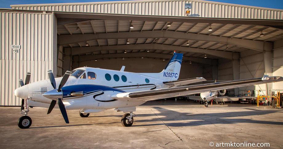 1979 beechcraft king air c90 parked outside hangar