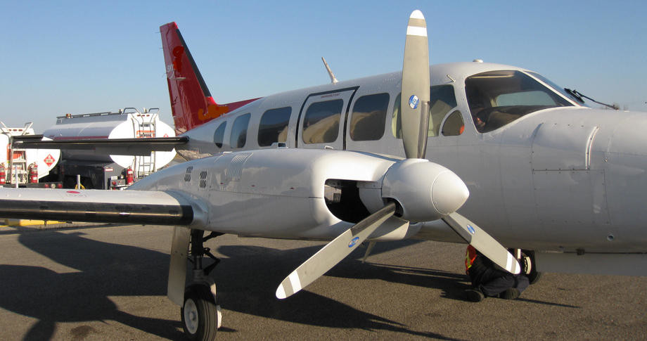 propeller view of a white 1980 piper chieftain with red stripes