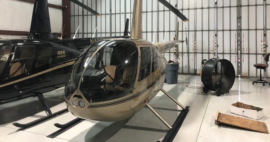Robinson R44 Raven II inside hangar