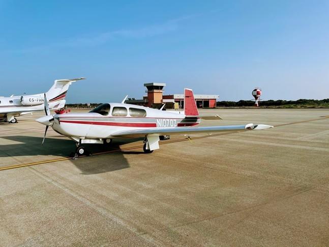 Mooney 252 on the runway