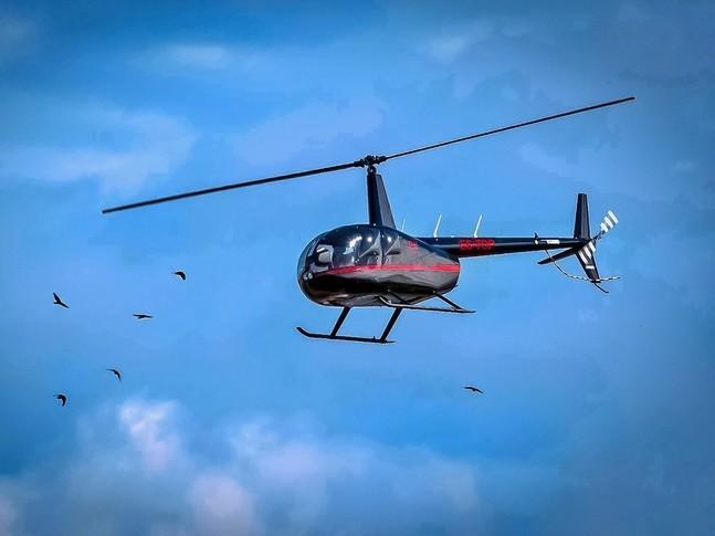 Robinson R44 Raven II In the sky