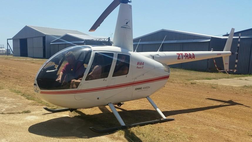 Robinson R44 Raven II on the runway