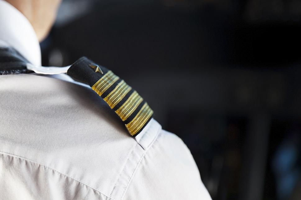 Pilot stripes - over-shoulder photo of pilot in cockpit