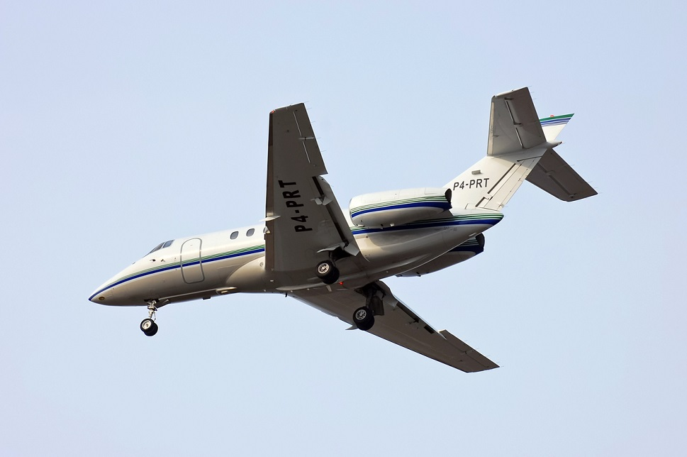 Hawker 800XP mid-size private jet flies overhead