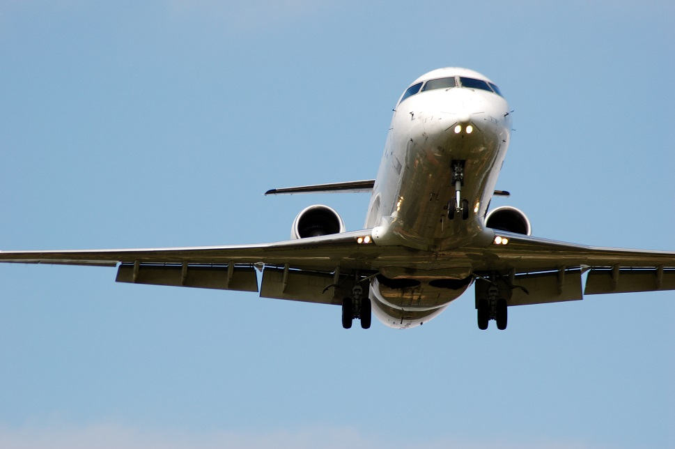A large business jet on final approach