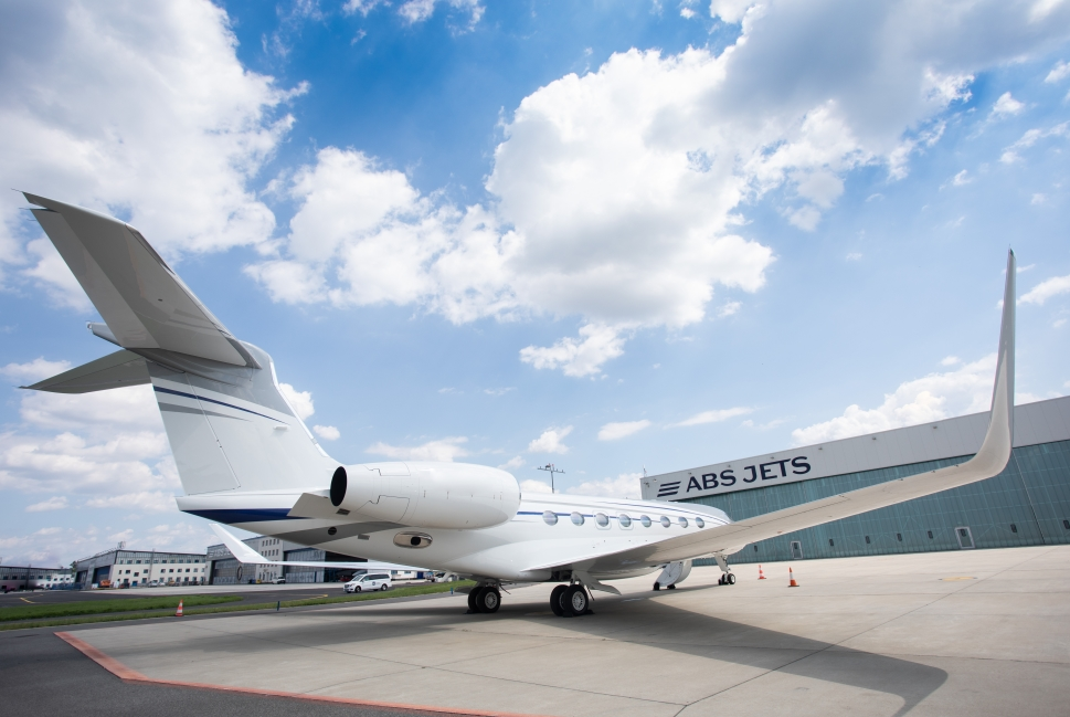 A Gulfstream private jet parked outside ABS Jets hangar