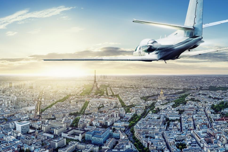 A light jet flies over Paris