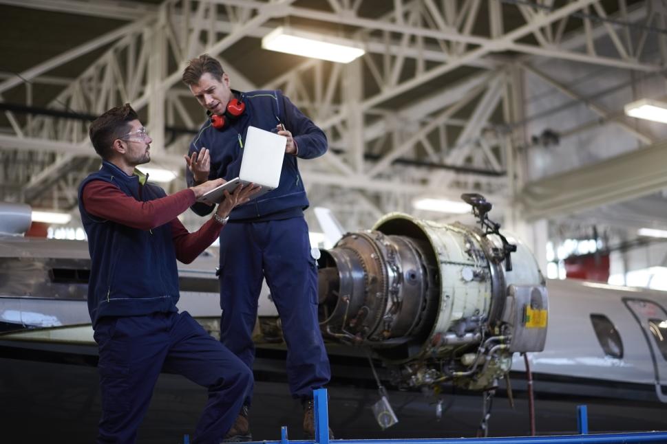 Technicians discuss private jet engine maintenance
