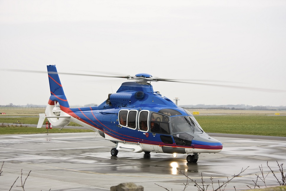 An AgustaWestland helicopter ready to take-off on helipad