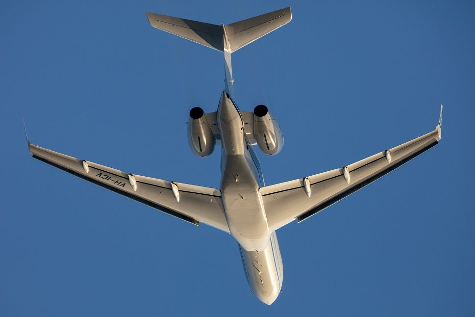 A Bombardier Global Express XRS soars in a clear blue sky