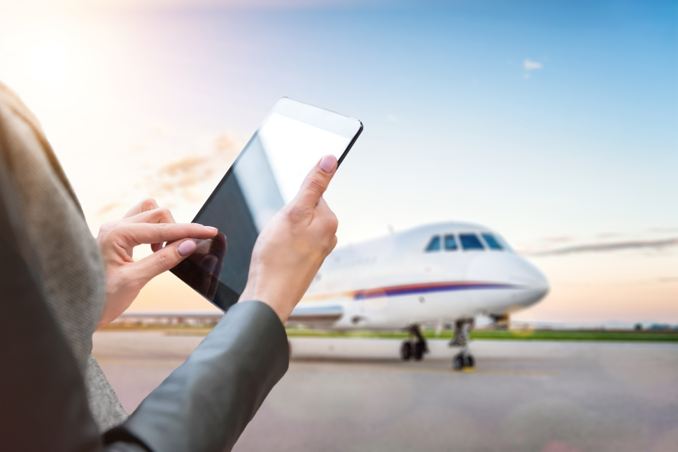 Executive selects their chartered private jet on an iPad