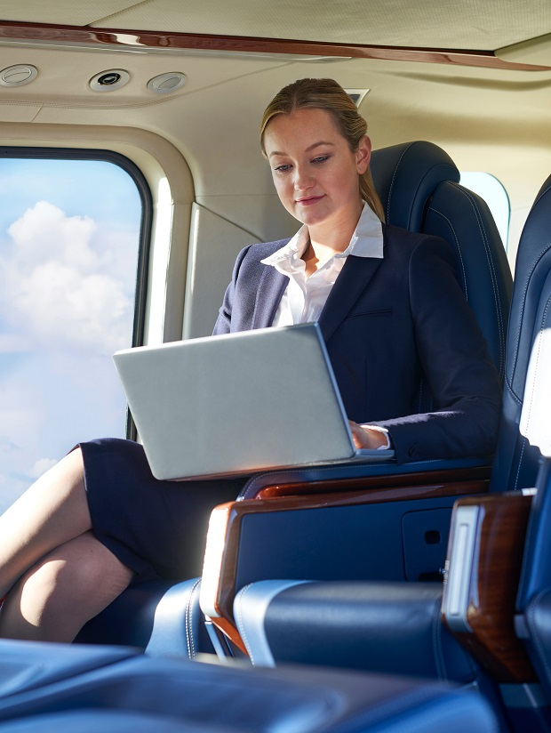 A business executive at work in a turbine helicopter cabin