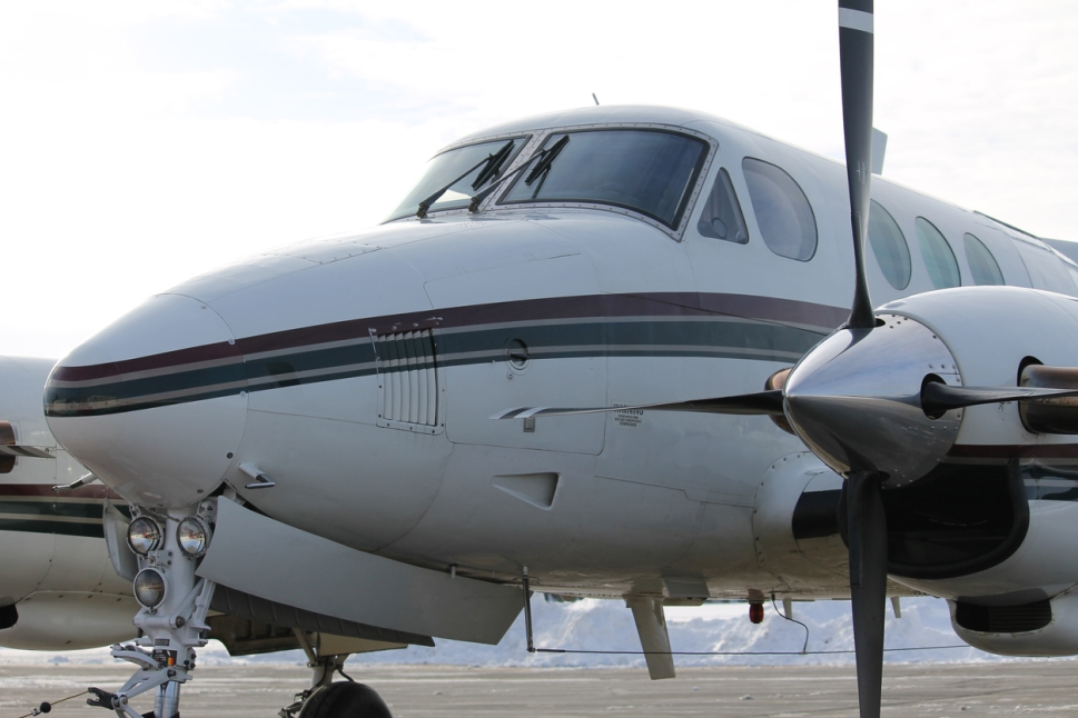 Front and propellers of a Beechcraft King Air C90 on the ground