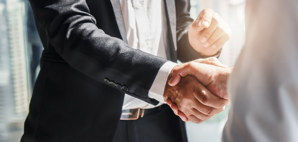 Business jet buyer and seller shake hands on a deal