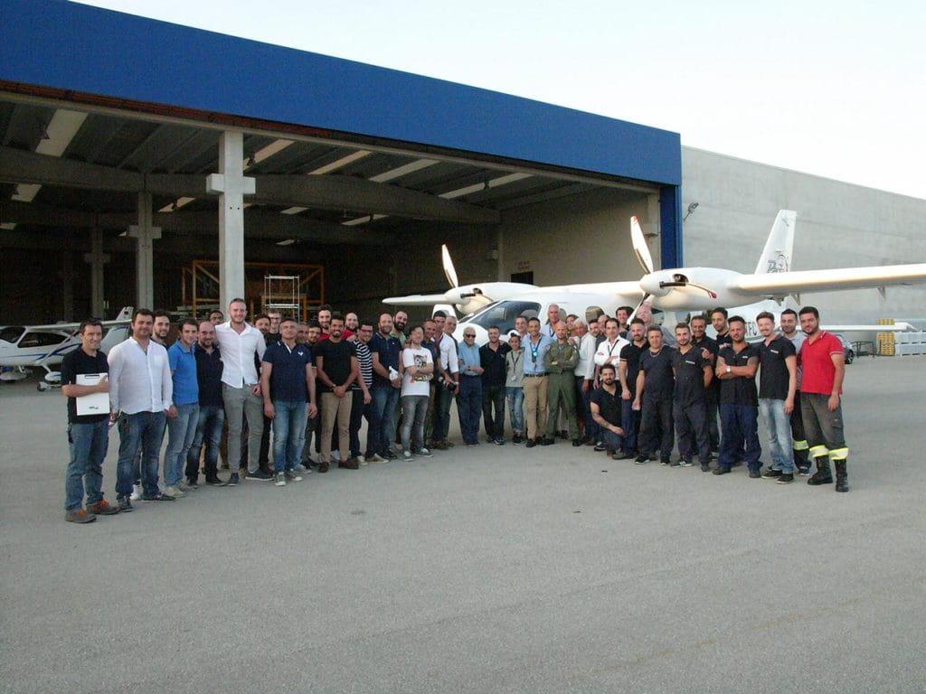 Tecnam P2012 Flight Team Personnel Outside Hangar