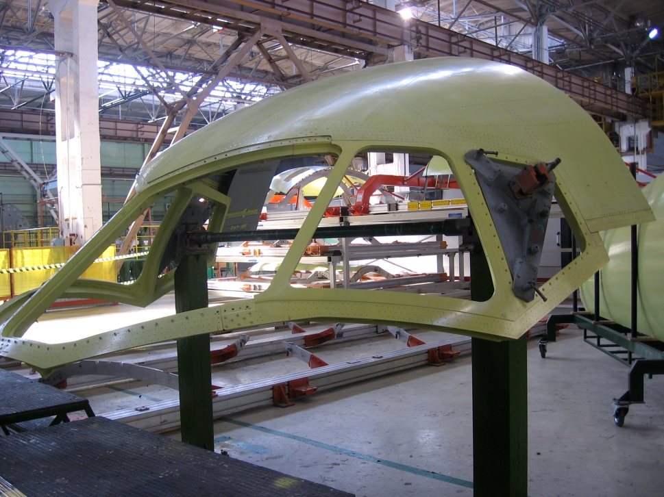 A section of aircraft fuselage awaiting assembly at manufacturing facility
