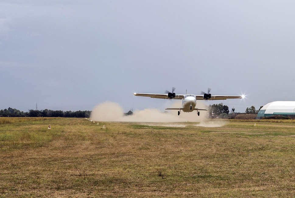 Tecnam's P2012 taking off from a grass runway