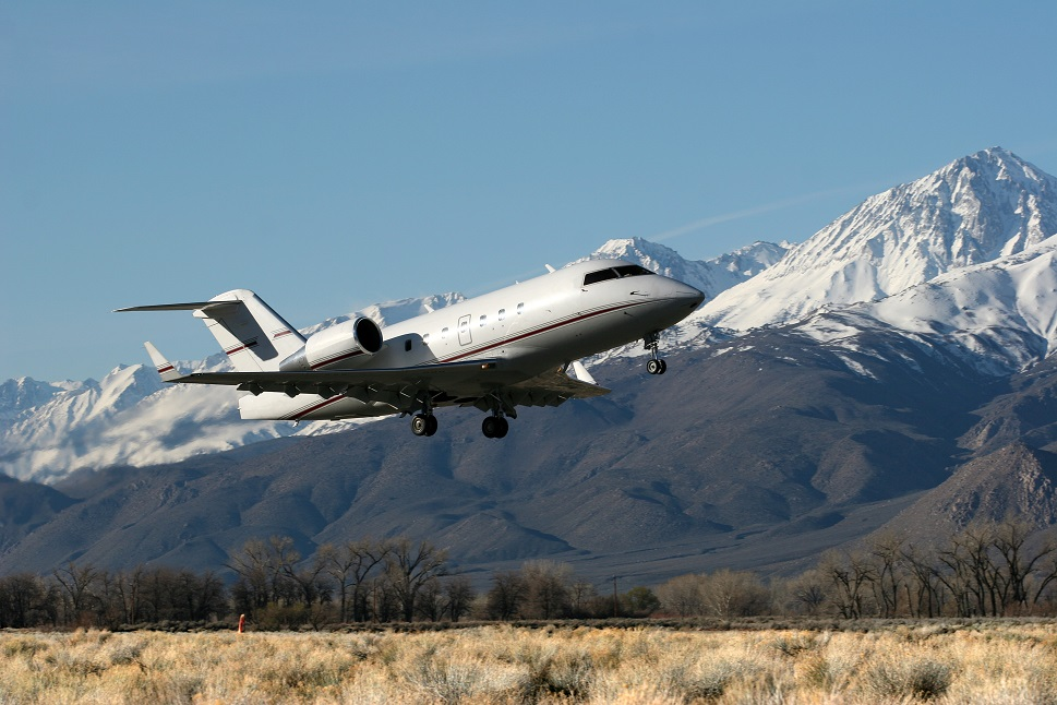 Bombardier Challenger 604 private jet lands near mountains