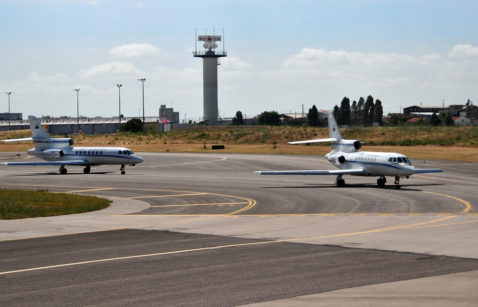 Dassault Falcon jets queued up on airport taxiway