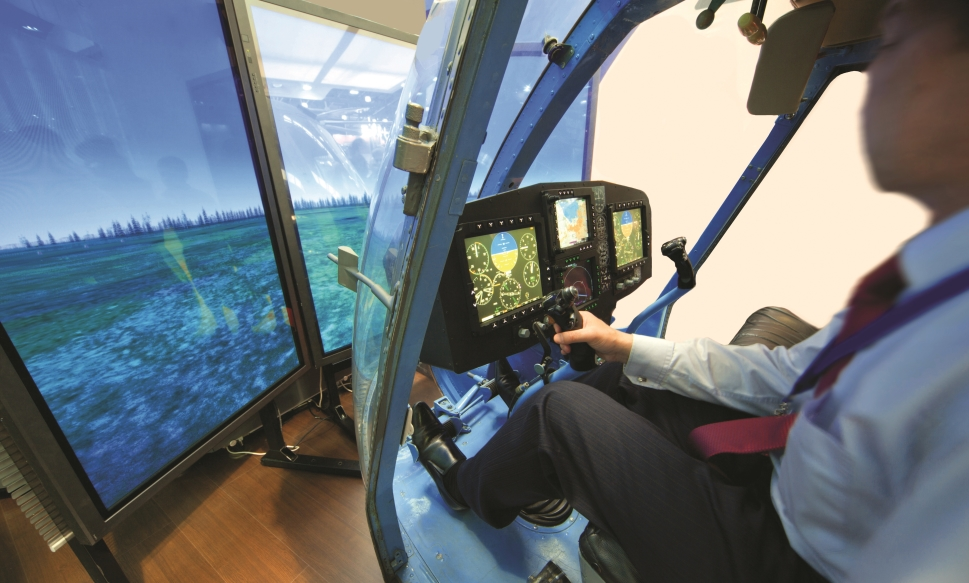 Trainee helicopter pilot engaged in simulator training