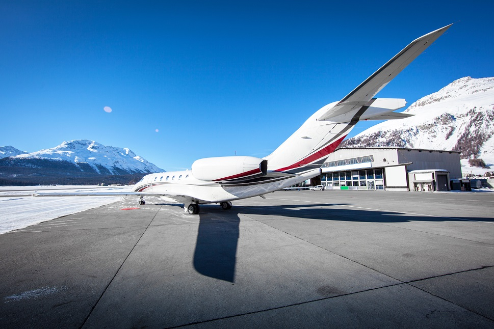 A Cessna Citation Jet parked at a mountain airport