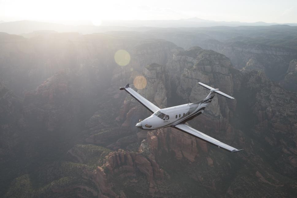A Pilatus PC-12 turboprop aircraft flies over Sedona, USA