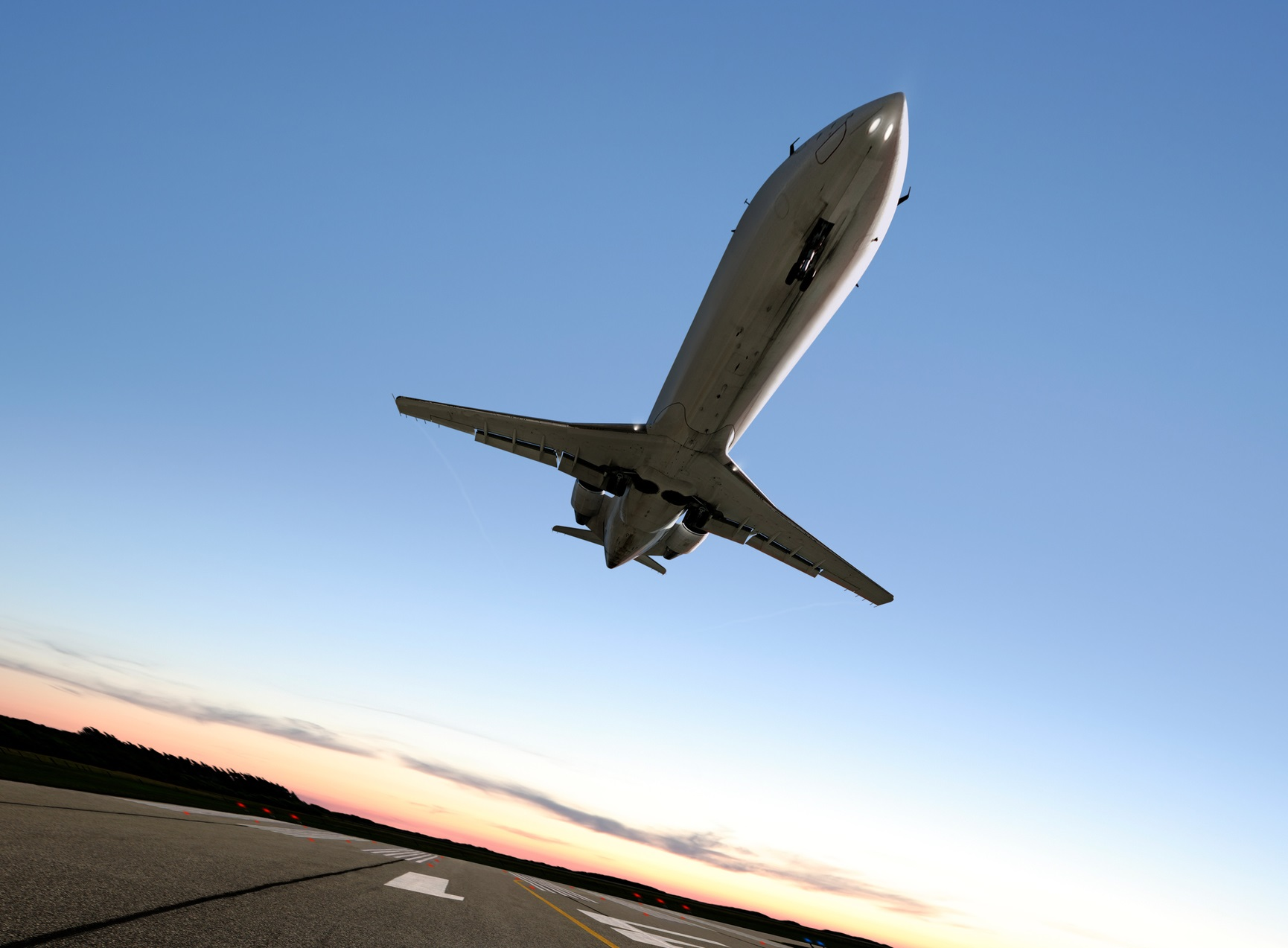 A private jet on take off flies overhead