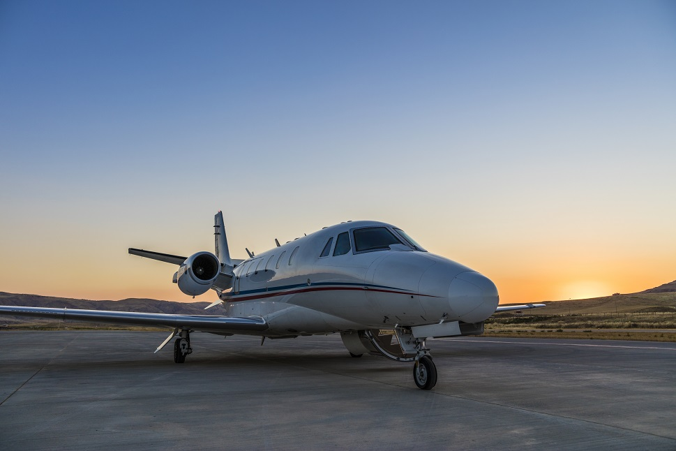 A Cessna Citation private jet waits to collect passengers