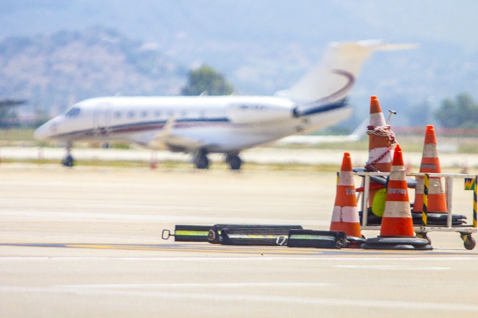 A heat haze blurs a parked Cessna Citation private jet