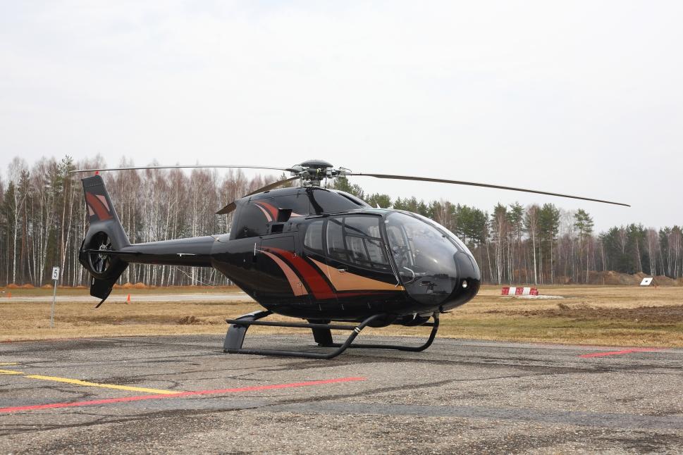 A Eurocopter EC120B parked on its helipad