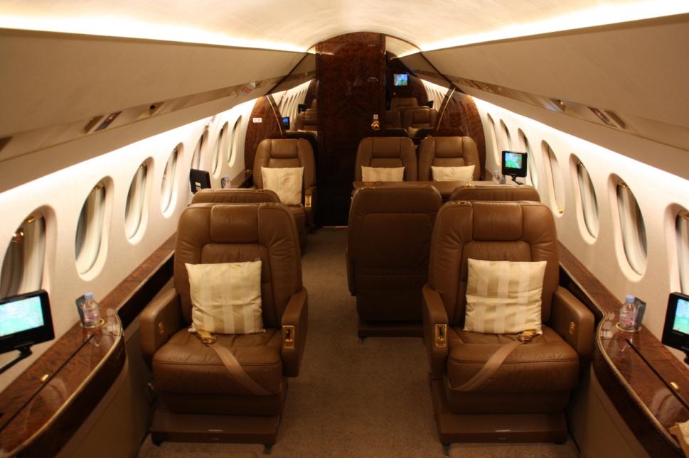 Dassault Falcon 2000 private jet cabin at night