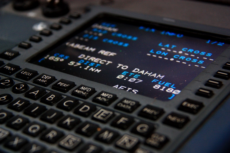 Private jet Flight Management System installed in cockpit